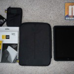Showing the iPad, case, bonus case, and iPad adapter and cord